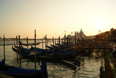 Sunset at the pier with a gondola Royalty Free Stock Images