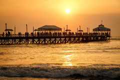 Sunset at pier of Huanchaco town, Peru. The romantic sunset time at pier of Huanchaco town, neat Trujillo, Peru royalty free stock photos