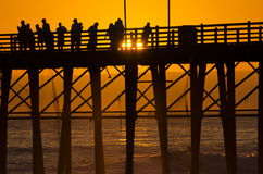 Sunset at the Pier. Huntington Beach at Sunset on the pier Stock Image
