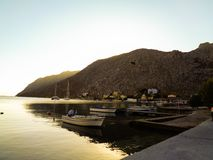 Sunset at the pier in fgreece. Sunset at the pier in karpathos in greece Stock Images