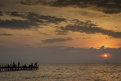 Sunset and pier in kep on cambodia coast. Sunset and pier view in kep on cambodia coast Royalty Free Stock Images