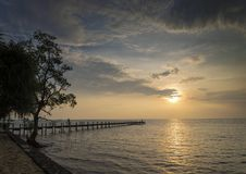 Sunset and pier in kep on cambodia coast. Sunset and pier view in kep on cambodia coast Royalty Free Stock Photography