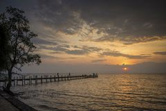 Sunset and pier in kep on cambodia coast. Sunset and pier view in kep on cambodia coast Royalty Free Stock Photos