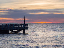 Sunset on the pier. Lonly Royalty Free Stock Photo