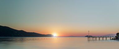 Sunset at the pier. In Mediterranean Royalty Free Stock Images