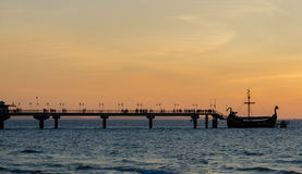 Sunset on a pier in Miedzyzdroje Poland Stock Photos