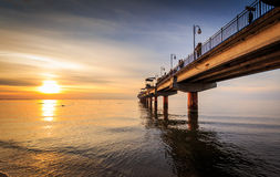 Sunset and pier in Miedzyzdroje Royalty Free Stock Image