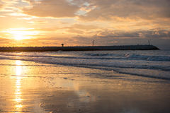 Sunset at the pier at the North Sea beach of Cadzand, Holland.  Stock Photos