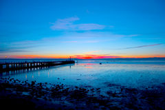 Sunset at the pier. A sunset in a portuguese pier Stock Images