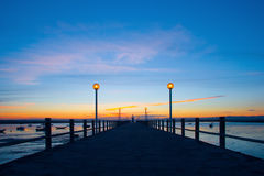 Sunset at the pier. A sunset in a portuguese pier with some boats in the scene Stock Photos