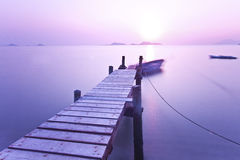 Sunset pier with purple mood Stock Photography