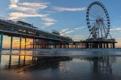 Sunset at the pier in Scheveningen Holland royalty free stock photo