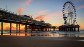 Sunset at the pier in Scheveningen Holland stock photo
