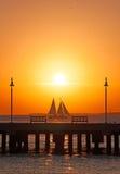 Sunset, pier, sea, sailboat, benches, Key West, Keys, Cayo Hueso, Monroe County, island, Florida. Key West, Keys, Cayo Hueso, State of Florida, Sunshine State Royalty Free Stock Photo