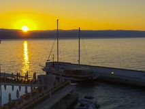 Sunset at the pier with ships. In the middle Stock Photo
