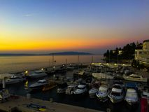 Sunset at the pier with ships. In the middle Royalty Free Stock Photos