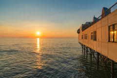 Sunset at the pier. In Aberystwyth, Ceredigion, Dyfed, Wales, UK Royalty Free Stock Image