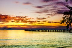 Sunset by pier on tropical beach on Koh Kood island in Thailand. View on sunset by pier on tropical beach on Koh Kood island in Thailand Stock Photography