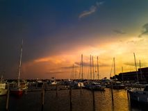 Sunset at the pier in venice. With the boats Stock Image