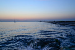 Sunset at pier  - water splash Royalty Free Stock Photos