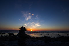 Sunset with Pile of Rocks Royalty Free Stock Images