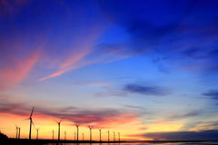 Sunset pink clouds. Taichung, Taiwan, Gaomei wetlands, sunset sunset views, with windmills Royalty Free Stock Photo