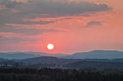 Sunset in pink over the wooded mountains Royalty Free Stock Photography