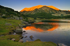 Sunset in Pirin mountain- the shadow of peak Muratov on peak  Todorka Royalty Free Stock Photography