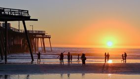 Pier on the Pismo Beach, Califoria. Sunset on the Pismo Beach in California. Pier, sand, beach, silhouettes Royalty Free Stock Images