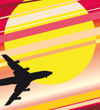 Sunset plane. Silhouette of the plane against a red decline Stock Images