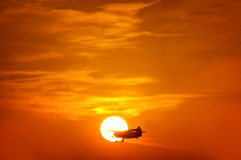 Sunset with Plane Royalty Free Stock Photography