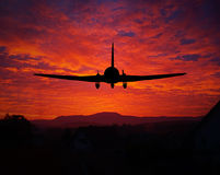 Sunset with a plane silhouette Stock Photography