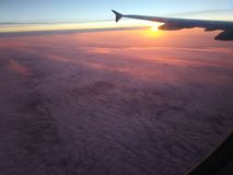 Sunset from the plane window. stock photos