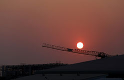 Sunset and plant currently under construction. Royalty Free Stock Photo