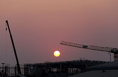 Sunset and plant currently under construction. Stock Photo