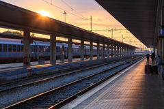 Sunset at the platform of a train station Stock Photos
