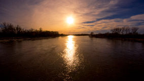 Sunset on the Platte River. A warm, late-winter evening with a beautiful sunset. Taken from the bridge on the Fort Kearney trail Royalty Free Stock Photos