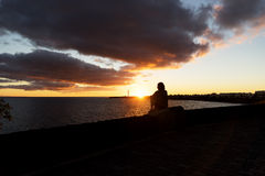 Sunset in Playa Blanca. As seen from the Boulevard with the lighthouse Pechiguera in the distance royalty free stock photos