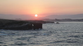 Sunset on Playa de las Catedrales Stock Images