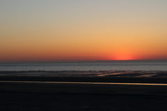 A sunset plunging into the cloudless  Sea On the beach of dunkerque Stock Photography