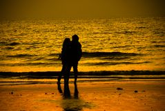 Sunset point loving moment on `Beach` royalty free stock photography