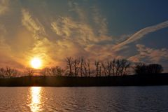 Sunset at the pond Stock Photography