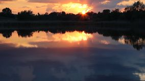 Sunset on the pond stock video