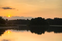 Sunset on the pond of museum-estate Kuskovo, Moscow. Royalty Free Stock Image