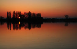 Sunset in pond with orange sky Royalty Free Stock Photos