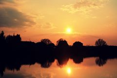 Sunset at the pond on the village Royalty Free Stock Images