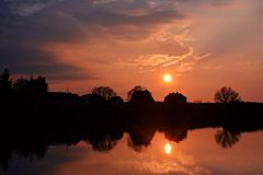 Sunset at the pond on the village Royalty Free Stock Photo