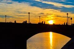 Sunset in Ponte alla Carraia alla Carraia Bridge, Florence, It royalty free stock photography