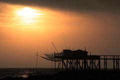 Sunset pontoon. Sunset by the sea on a fishing dock Stock Photography