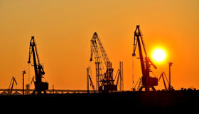 Sunset in the port. Marine port at sunset of a sun Stock Photo